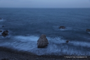 The thrown rocks in the sea at dusk